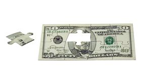 Le puzzle de l'argent Photographie stock
