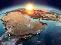 Le Qatar de l'espace dans le lever de soleil Photo stock
