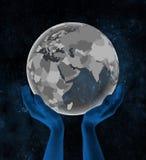 Le Qatar sur le globe dans des mains dans l'espace illustration de vecteur