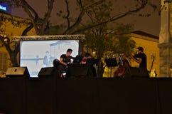 Le quartet de T'ang a exécuté la nuit 2015 rivière de Singapour Photo stock