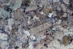 Le résumé a formé d'un plan rapproché d'une surface en pierre polie Photo stock