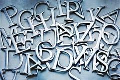 Le résumé marque avec des lettres le fond d'alphabet Photographie stock libre de droits