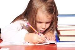 Le ragazze imparano i libri sepolti fotografie stock libere da diritti