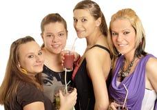 Le ragazze sono felici nel banco Immagine Stock
