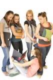 Le ragazze sono felici nel banco Fotografia Stock
