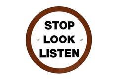 Le regard d'arrêt écoutent signe Photo stock