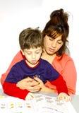 Le relevé de mère et d'enfant Photographie stock