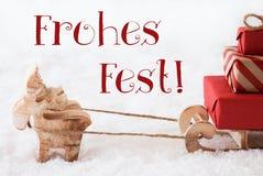 Le renne avec le traîneau sur la neige, Fest de Frohes signifie le Joyeux Noël Images stock