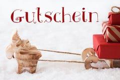 Le renne avec le traîneau sur la neige, Gutschein signifie le bon Photos stock