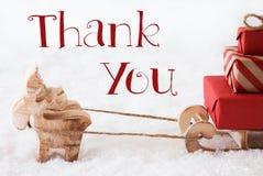 Le renne avec le traîneau sur la neige, texte vous remercient Photos stock