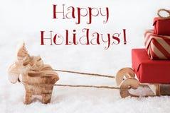 Le renne avec le traîneau sur la neige, textotent bonnes fêtes Photographie stock