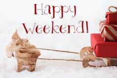 Le renne avec le traîneau sur la neige, textotent le week-end heureux Photos stock
