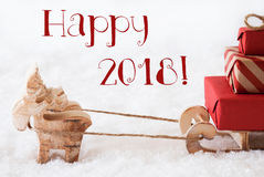 Le renne avec le traîneau sur la neige, textotent 2018 heureux Photo stock