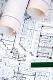 Le retrait et les plans de l'architecte Image stock