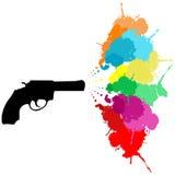 Le revolver avec la peinture colorée éclabousse Image stock