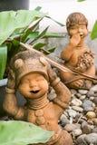 Le rire bébête badine la statue Photos libres de droits