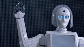 Le robot indique bonjour, fait des gestes avec le bras bionique