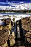 Le rocce e le onde a Balmoral tirano, l'Australia Immagini Stock Libere da Diritti