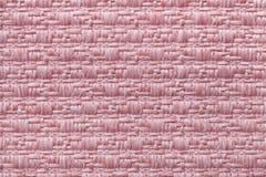 Le rose a tricoté le fond de laine avec un modèle de tissu mou et laineux Texture de plan rapproché de textile Image libre de droits