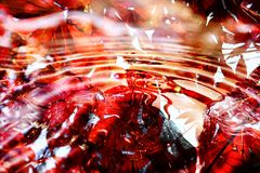 Le rouge abstrait laisse le fond Images stock