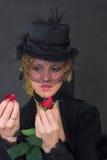 Le rouge de witth de femme a monté images libres de droits