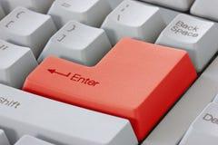 Le rouge entrent dans le bouton sur le clavier Photographie stock
