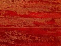 Le rouge et l'or ont donné au marbre une consistance rugueuse en tant que des milieux Photo libre de droits