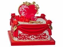 Le rouge et le blanc ont glacé le gâteau. Images stock