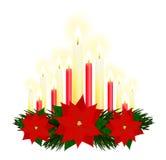 Le rouge mire la flamme de Noël Image stock