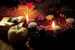 Le rouge mire la flamme de Noël Photo stock