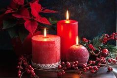Le rouge mire la flamme de Noël Photographie stock
