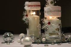 Le rouge mire la flamme de Noël Images libres de droits