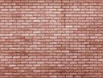 Le rouge orange a modifié la tonalité le mur de briques répétant le modèle image stock