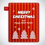 Le rouge a tricoté le label de pin de Noël Photo stock