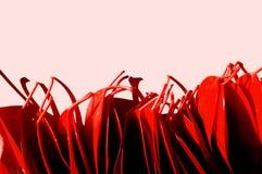 Le rouge vibrant laisse le fond de photo sur pâle - fond rose Aut image libre de droits