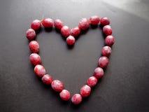 Le rouge viole dessiner un coeur Photographie stock