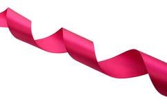 Le ruban rouge enroulent dans une spirale sur la diagonale Image stock
