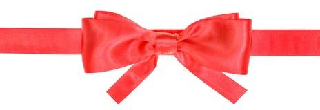 Le ruban rouge et le vrai arc avec la place ont coupé des extrémités Images libres de droits