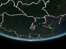 Le Rwanda sur terre de l'espace la nuit Photos libres de droits