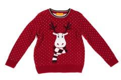 Le ` s d'enfants a tricoté le chandail avec un modèle de cerfs communs Isolat sur le blanc photos libres de droits