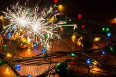 Le ` s de nouvelle année allume et joue 10 Images stock