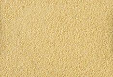 Le sabbie del cuscus strutturano il fondo nutrizione bio- Ingrediente di alimento naturale fotografie stock libere da diritti