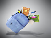 Le sac à dos bleu avec les fournitures scolaires 3d rendent sur le gris Image stock