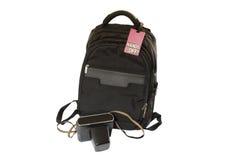 Le sac avec se connectent lui et l'appareil-photo sur le fond blanc Photo stock