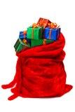 Le sac de Santa a rempli de cadeaux Photographie stock libre de droits