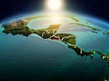 Le Salvador dans le lever de soleil de l'orbite image libre de droits