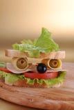 Le sandwich ressemble au visage Photographie stock