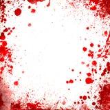 Le sang rouge de petit morceau blanc de fond éclabousse des frontières Image stock