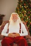 Le santa utan hans koppla av för omslag Royaltyfri Fotografi