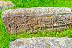 Le scene di vita del villaggio sulla pietra tombale Fotografie Stock Libere da Diritti